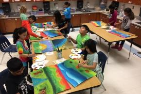 students painting in art class